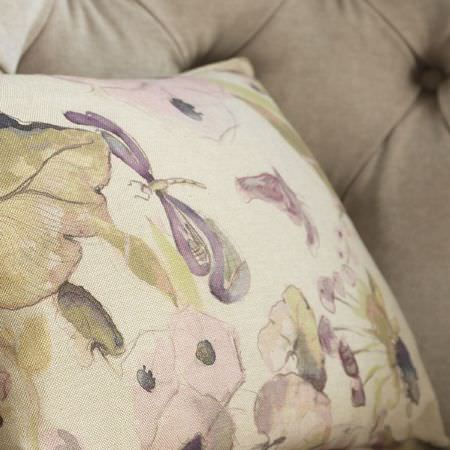 Fibre Naturelle -  Melody Fabric Collection - Close-up view of a cushion dyed in light beige shade and featuring a pattern of flowers and dragonflies
