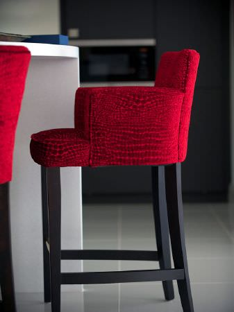 Fibre Naturelle -  Milano Fabric Collection - Bright red armchair style bar stool with long dark wood legs