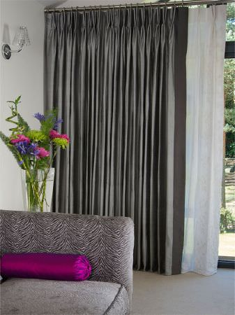 Fibre Naturelle -  Monsoon Fabric Collection - Grey striped curtains, with a grey animal stripe sofa, magenta cushion and a tall, square, flared vase