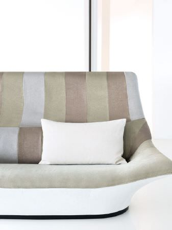 Fibre Naturelle -  Monza Fabric Collection - White, stone, green and blue coloured sofa with a white cushion