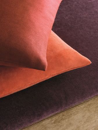 Fibre Naturelle -  Monza Fabric Collection - Terracotta and orange scatter cushions on an aubergine and green fabric sofa base