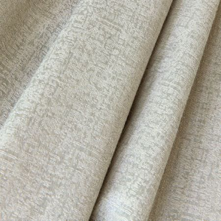 Fibre Naturelle -  Night Owl Fabric Collection - Fabric made out of natural fibres dyed in a very light shade of beige with a conventional design