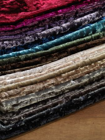 Fibre Naturelle -  Panther Fabric Collection - Folds of numerous bright, textured, velour effect fabrics in plain black, brown, beige, green, blue, purple and red shades