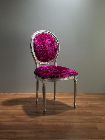 Fibre Naturelle -  Panther Fabric Collection - A single chair made with an ornate silver wood frame, a padded seat and back covered with textured bright magenta fabric