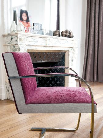 Fibre Naturelle -  Santa Cruz Fabric Collection - Maroon velvet effect chair with beige sides and curving metal armrests and legs, with brown curtains and an assortment of vases