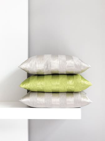Fibre Naturelle -  Soho Fabric Collection - A simple white shelf with three subtly striped, slightly shiny cushions; two in silver with the middle one in lime green