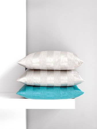 Fibre Naturelle -  Soho Fabric Collection - Two silver cushions sitting on a bright aqua blue cushion, all with subtle stripes, sitting atop a simple white shelf
