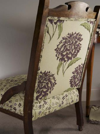 Fibre Naturelle -  Tivoli Fabric Collection - Wooden chair with a green and purple-grey floral seat, and a back covered in matching hydrangea printed fabric