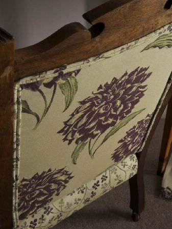 Fibre Naturelle -  Tivoli Fabric Collection - Purple and green hydrangea print fabric on the back of a dark wood chair