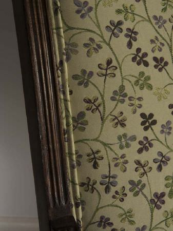 Fibre Naturelle -  Tivoli Fabric Collection - Purple and pale green patterned fabric next to carved dark brown wood
