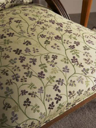 Fibre Naturelle -  Tivoli Fabric Collection - Green and purple floral design embroidered onto a chair seat