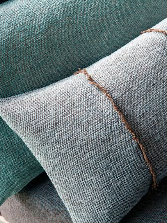 Fibre Naturelle -  Verona Fabric Collection - Cushions with thick fabric covers; one in aqua, one in pale blue with brown twine wrapped around it