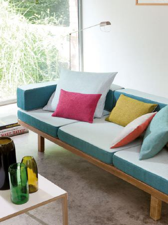 Fibre Naturelle -  Verona Fabric Collection - Wooden frame with white and aqua sofa cushions, scatter cushions in white, orange, pink, light blue and yellow, with a table and glass vases