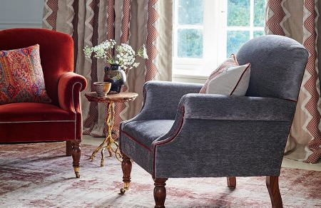GP and J Baker -  Cosmopolitan I Fabric Collection - Matching plain design on upholstered armchairs in vibrant red shade and dark shade of grey