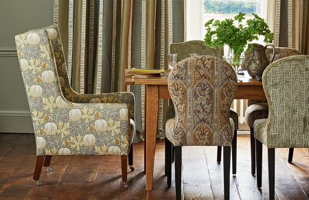 GP and J Baker -  Cosmopolitan I Fabric Collection - Upholstered armchair and upholstered dining chairs featuring different elegant decorative patterns