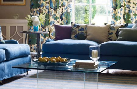 GP and J Baker -  Crayford Fabric Collection - Vibrant blue sofas, plain green, blue and purple cushions and beige curtains and cushions with blue floral design