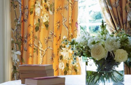 GP and J Baker -  Crayford Fabric Collection - Elegant curtains dyed in a darker shade of orange decorated with a modern pattern of flowers