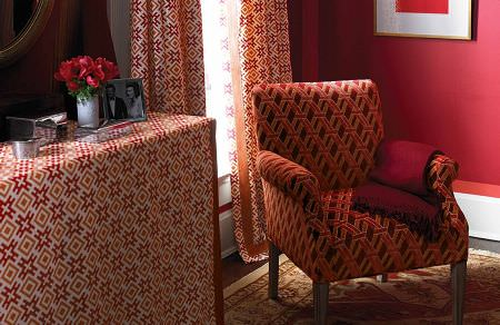 GP and J Baker -  David Hicks III Fabric Collection - Vibrant pattern of red and orange geometric figures on white curtains and fabric covering furniture