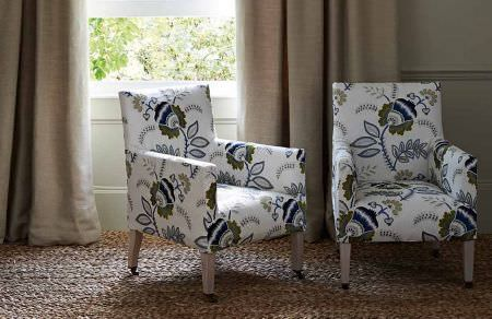 GP and J Baker -  Larkhill Fabric Collection - Elegant upholstered chairs in white featuring wooden legs and a modern pattern of big flowers