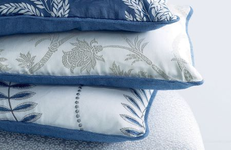 GP and J Baker -  Marwood I Fabric Collection - A set of cushions that are plain and blue on one side and white on the other side with a floral design