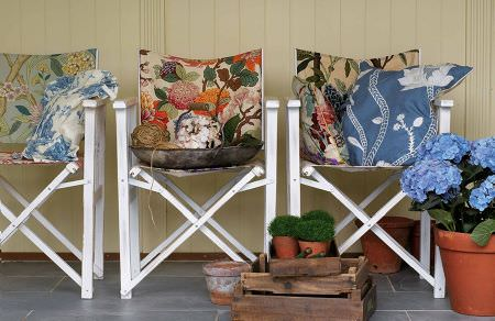 GP and J Baker -  Oleander Embroideries Fabric Collection - Three chairs featuring different embroidered floral patterns and cushions with simple floral designs