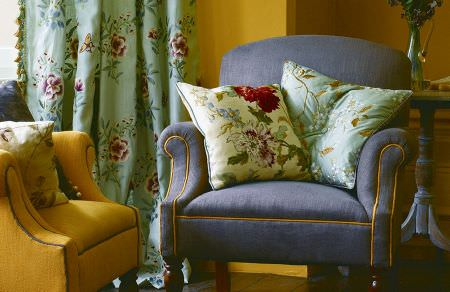 GP and J Baker -  Oleander Embroideries Fabric Collection - Matching design on mint green curtain and a cushion and plain orange and light blue armchairs