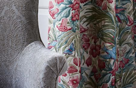GP and J Baker -  Originals V Fabric Collection - White curtain decorated with a floral design in red and blue and white armchair with embroidered design
