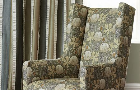 GP and J Baker -  Originals V Fabric Collection - Upholstered armchair in a dark shade of grey decorated with autumn-inspired floral pattern