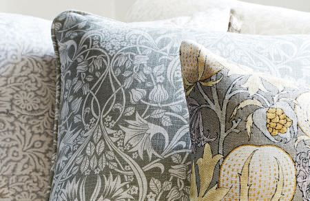 GP and J Baker -  Originals V Fabric Collection - Beige cushion with white floral design, grey cushion with floral pattern and grey cushion with autumn-inspired design