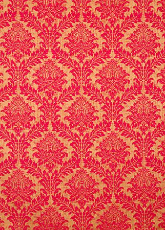 GP and J Baker -  Simply Damask Fabric Collection - Vibrant beige fabric decorated with a velvet floral pattern in a vibrant shade of colour red