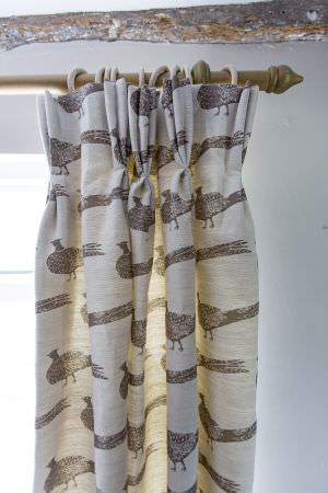 Hannah Watchorn Designs -  Hannah Watchorn Designs Fabric Collection - Grey pheasants printed on off-white curtains, hanging from a simple wooden curtain pole