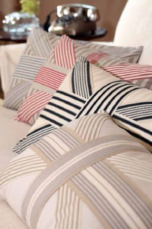 Ian Mankin -  Ian Mankin Fabric Collection - Cushions with neutral backgrounds with bold stripes in beige, pink and black in Union Jack format.