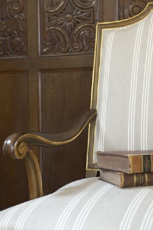 Ian Mankin -  Ian Mankin Fabric Collection - Armchair with stone coloured fabric with white stripes.