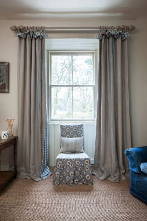 Inchyra -  Linen Ticking and Gingham Fabric Collection - Floral chair cover, white cushion decorated with light blue stripes and elegant vintage curtains
