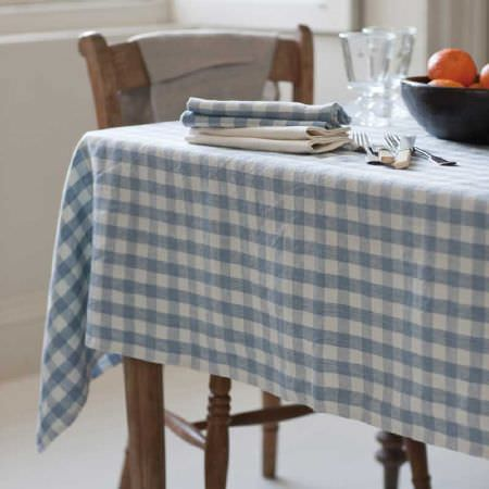 Inchyra -  Linen Ticking and Gingham Fabric Collection - Chequered design featuring a pattern of small white and blue squares on a tablecloth and napkins