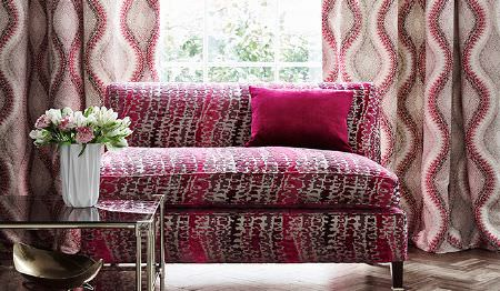 James Hare -  Carnaby Velvet Fabric Collection - Beige curtains featuring wavy red pattern and a red upholstered sofa decorated with an abstract pattern