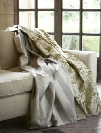 James Hare -  Chinon Silks Fabric Collection - Plain beige sofa and two sofa covers, one in light grey with white stripes and the other in beige with floral pattern