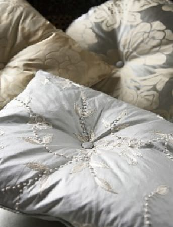 James Hare -  Chinon Silks Fabric Collection - A set of elegant silky cushions in beige, grey and silver decorated with modern floral patterns