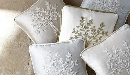 James Hare -  Orchard Silk Fabric Collection - Five scatter cushions in white and very pale grey, beige, blue and green, each with a simple embroidered tree design