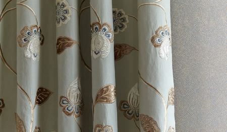 James Hare -  Oriel Silks Fabric Collection - Draped floral patterned fabric made with a fun design invery pale blue, white and several light shades of brown