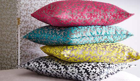 James Hare -  Portobello Fabric Collection - A stack of 4 fun, patterned scatter cushions in hot pink and grey, sky blue and grey, citrus and silver, and black and white