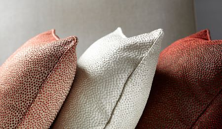 James Hare -  Shagreen Silk Fabric Collection - Three subtly speckled cushions; one in red and cream, one in white, and one in burgundy and gold