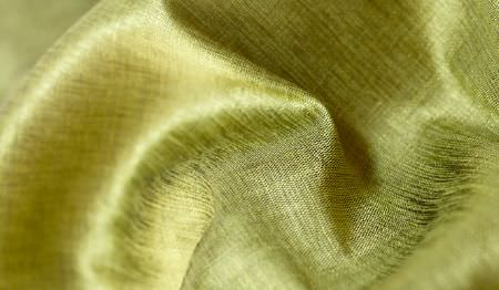 James Hare -  Soho Silk Fabric Collection - Swathes of slightly shiny plain kiwi green coloured fabric