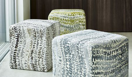 James Hare -  Tempo Fabric Collection - Three modern square ottomans decorated with a matching abstract pattern in yellow, grey and silver