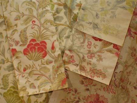 Jim Dickens -  Acquitaine Fabric Collection - Swatches of ornately patterned floral fabrics, mostly in shades of green and champagne, but with some red, light blue and grey elements