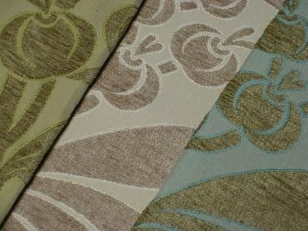 Jim Dickens -  Alicante Fabric Collection - A large, stylised pattern of fruit and leaves on fabrics in 3 different colours; two shades of green, two shades of brown , and green and blue