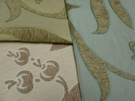 Jim Dickens -  Alicante Fabric Collection - A slightly textured large pattern of leaves and berries in green and brown on three different fabrics in green, blue and very light brown
