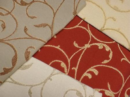 Jim Dickens -  Alicante Fabric Collection - Red, cream, white and grey fabrics, all patterned with simple swirls, in either gold, grey or brown