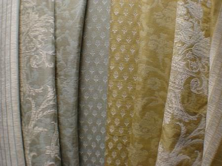 Jim Dickens -  Avalon Fabric Collection - A selection of four different patterned fabrics, each pattern shown in both the silver and the gold colour options