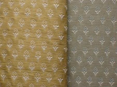 Jim Dickens -  Avalon Fabric Collection - Gold fabric patterned with tiny, individual flower shapes arranged in rows, beside a swatch of the same fabric in shades of silver and grey